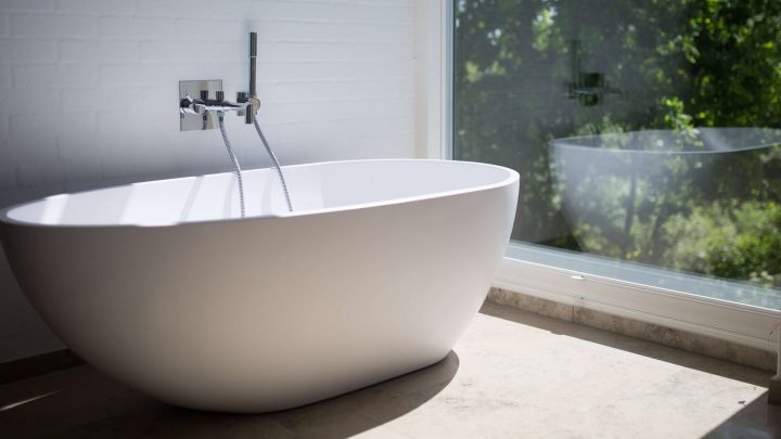 white-ceramic-bathtub-beside-clear-glass-wall (1)